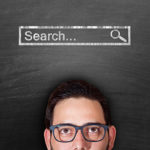 Man looking at blackboard to explain why search engine optimisation (SEO) is critical for companies and businesses
